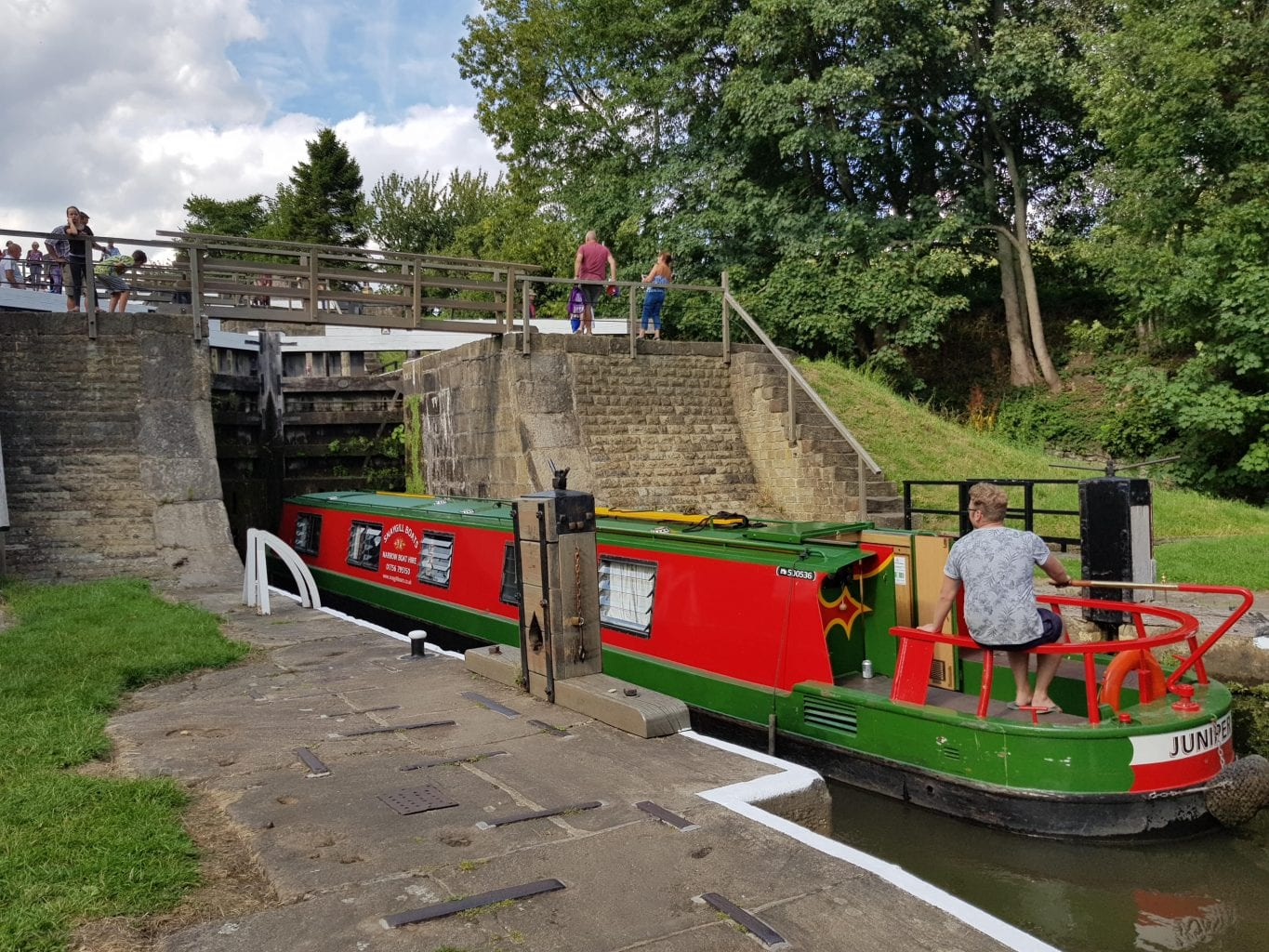 A houseboat making its way up the Bingley Five Rise Lock.