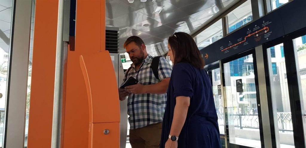 Buying a NOL card at a tram vending machine Dubai